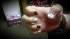 Classic black and white, but with a cute little panda on the thumb! A white background, small dots by a bobby pin, and larger dots by the end of a pen.