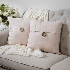 Spruce up your space with a set of pretty pillows. This matching set adds subtle color and sophistication to your living space without the hard work.