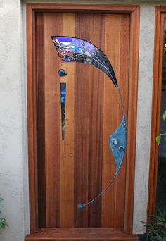 Stained Glass and Wood Entry Door by James Hubbell