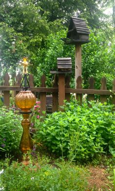 Re-purposed glass and metal into garden art.