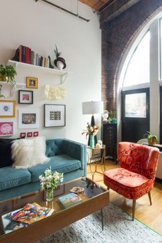 """Another bold choice was the bright <a href=""""https://www.anthropologie.com/shop/dhurrie-occasional-chair?color=083&quantity=1&size=ALL&type=REGULAR"""">orange dhurrie occasional chair</a>."""