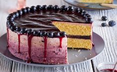 This berry ombre cake recipe makes for a real showstopper. The ombre is all in the icing – with mixed berry jam swirled into buttercream, smoothed over a gorgeous vanilla sponge with a jammy fruity filling.