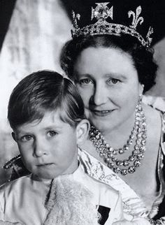 *QUEEN MOTHER ELISABETH ~ with her adorable grandson Prince Charles .The photo was taken the day of Queen's Elizabeth II coronation. Her mother is wearing a tiara with the famous Koh-i-Noor diamond, plus the necklace with Queen Victoria's diamonds!