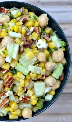 This Chickpea Corn Salad is loaded with delicious fresh ingredients. The flavors from roasted pecans, cilantro, and feta leaves everyone wanting more.
