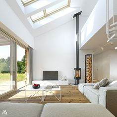 RODZINNY 2 - projekt domu z antresolą - Duży salon z tarasem / balkonem z antresolą, styl skandynawski - zdjęcie od DOMY Z WIZJĄ - nowoczesne projekty domów
