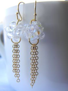 Crystal beaded earrings with gold plated tassel par LindaMunequita, $15,00