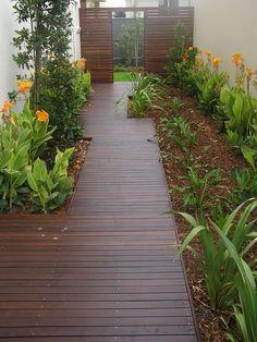 Top 50 Best Wooden Walkway Ideas - Wood Path Designs - - From rustic tree stumps to modern herringbone cut patterns, discover the top 50 best wooden walkway ideas.