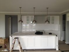 Liking the lights, and grey walls with white cabinetry. Hamptons Kitchen, Hamptons Decor, Before After Home, Kitchen Benches, Building A New Home, Building Ideas, White Kitchen Cabinets, Kitchen Reno, Grey Walls