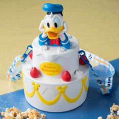 """Brand new Donald Duck Popcorn Bucket at Tokyo Disneyland and Tokyo DisneySea for Donald Duck's Birthday! Learn more about """"Donald's Happy Birthday to Me!"""" at Tokyo Disney Resort. Disneyland Food, Tokyo Disneyland, Disney Food, Walt Disney, Donald Duck Cake, Disney Popcorn Bucket, Disney Tote Bags, Bithday Cake, Ballerina Cakes"""