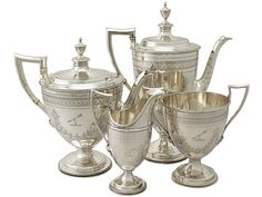 'Antique Silver Tea and Coffee Service' An exceptional, fine and impressive antique Victorian English sterling silver four piece tea and coffee service/set made by Barnard & Sons Ltd.