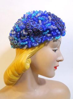 70s cobalt blue velvet hat with blue leather disc appliques, beads and sequins. Soft side, loose beret style. By Christian Dior. a bit of a 70s gypsy effect! One size.    $145