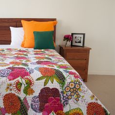 Floral Kantha Quilt: This gorgeous floral quilt is made using traditional Kantha running stitch. Kantha is one of the oldest form of art from India. It fits king/queen size bed and can be used as a bedspread or as a gorgeous throw to add colour to your living space. Features: Kantha stitch Cotton material Fits King/Queen size Quilt/Bedspread/Throw Reversible Suitable for all seasons Dry clean Madie in Jaipur, India Size: 240cm x 290cm