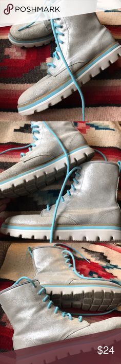 Skechers Grey Moto Boots size 8 Wow! Really cool with the contrasting aqua trim and laces. Pre-loved and in good shape. Uppers are leather, and considering that they are in good shape compared to how boots can get dinged up....  Shop smart by maximizing your shipping $. Use the filter function and peruse my closet of over 1,000 items! Bundle and save!!    D4 Skechers Shoes Combat & Moto Boots