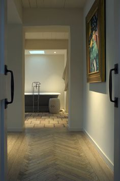 Herringbone flooring - changing space boundaries