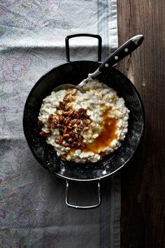 Greek yogurt oatmeal with browned butter honey and candied pine nuts