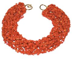Helga Wagner Eight Strands of Dyed Coral chips with tiffany clasp.