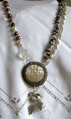 Old mother-of-pearl brooch turned into a necklace with stone beads