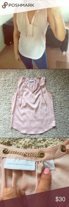 Baby pink gold chain top Size is XS but runs bigs and would fit a small or medium. NO damages or rips. In excellent condition New York & Company Tops Blouses