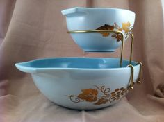 Pyrex Chip and Dip Set Bracket. Just got one of these sets as a christmas present! Blue delphite glass makes this promo set from 1960 beautiful and hard to find.  The grape vine pattern is gold leaf!