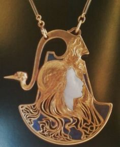 Lalique woman and swan pendant