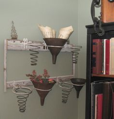 DIY Craft Projects - Trash to Treasure - Architectural Salvage. old springs wood and funnels!
