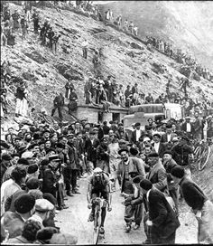 Antonin Magne climbs the legendary Tourmalet in the 1930 Tour de France and is being cheered by thousands of supporters.