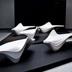 Serac Bench by Zaha Hadid for Lab23. Milan 2013: Zaha Hadid imagined a block of ice formed in the crevasses of a glacier for the design of this bench...The surface of the bench is shaped into a series of smooth ridges and curves, and a single arch forms a backrest on one side.