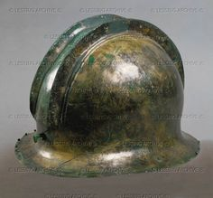 HALLSTATT CULTURE HELMET 10TH-6TH BCE Helmet with a double crest Bronze Naturhistorisches Museum, Vienna, Austria
