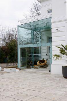 single glazed glass extension with single glazed sliding folding doors open    www.iqglassuk.com