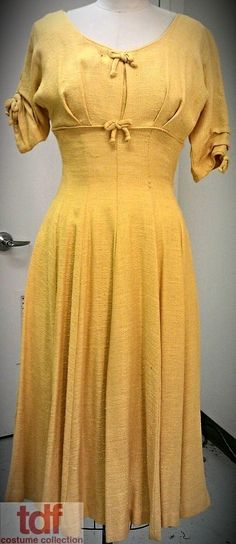 Once again, a dress that has no beads! It is a beautiful canary yellow and Sue the Silent would wear this in Finian's Rainbow. It feels like a dress that must be danced in. #1950s #TDFCC #KeepingUpWithTheCostumes