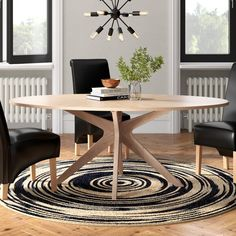 Featuring an eye-catching silhouette and an oak finish, this dining table seats up to eight people—perfect for country and contemporary looks alike.