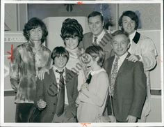 """the monkees on the set of """"hollywood squares"""" in december 1968, with peter marshall, judy carne, joanne worley, and henry gibson."""