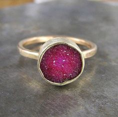 red quartz in gold ring.