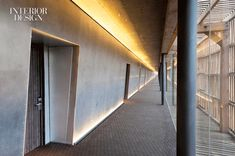 LED fixtures illuminate guest corridors paneled in steel. Courtesy of Singular Hotels.