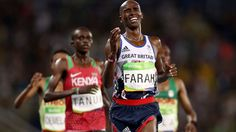 Farah grimaces as he crosses the line to win the 10,000m after a tough race
