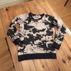 Chloe K Tie Dye Quilted Shoulder Sweatshirt NWOT. Very unique design! Typical sweatshirt fit, but quilted shoulders and zipper add something extra! Colors are black and gray Chloe K Sweaters