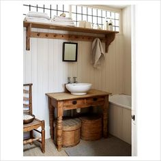 antique table as bathroom sink... this is awesome!