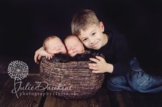 Newborn twins with sibling