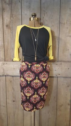 LuLaRoe Cassie with Randy... Knotted and rolled. Dress the shirt up and the skirt down... To shear perfection.  www.facebook.com/groups/lularoewitbetsy