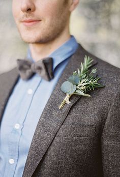 Brides.com: . A boutonniere comprised of eucalyptus and fresh herbs, created by Floral Earth.