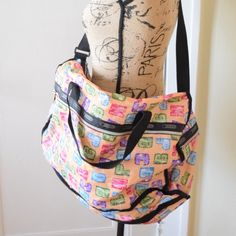 Lesportsac Large Weekender Beautiful large Lesportsac weekender in alphabet print. Rainbow zipper. 13.75 x 20.75 x 10.5 in. Zipped main closure, Exterior front and back pockets with zipped closures, Two exterior side pockets with zipped closures, Top handles, Adjustable shoulder strap. Excellent condition. LeSportsac Bags Travel Bags