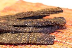 South African Biltong - Biltong is South Africa's version of beef jerky. Biltong is thicker than jerky and is cured using vinegar and salt before being dried over a few days. - just got a box to start making it! Jerky Recipes, Beef Recipes, Snack Recipes, Cooking Recipes, Snacks, Dessert Recipes, Beef Jerky, Venison, Gourmet