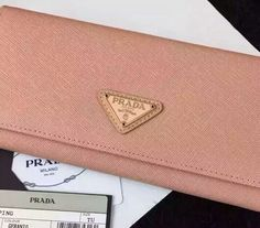 PRADA Saffiano leather flap wallet with enamel triangle logo geranio