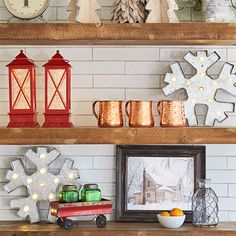 Add decor to open shelving in the kitchen. Transform this high-profile spot for the holiday season and beyond. Swap out a few everyday items for decor such as mini trees, lighted red lanterns and lighted snowflake ornaments. In an open-plan space, the kitchen shelf decor will relate to the adjoining rooms.