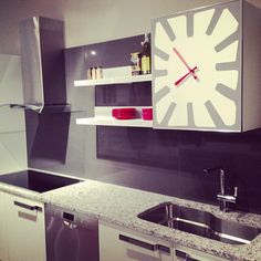 Time for dinner! We love the clock / cabinet door on this new Italian kitchen from Bontempi Cucine.