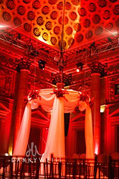 Red and white wedding. Chuppah with draping and soft columns by Diana Gould Ltd.  At Capitale NY.  Photo by Danny Weiss Photography.