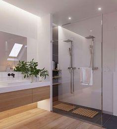 Banheiro para inspirar✨Iluminação clean deixou o ambiente mais sofisticado project by @zrobym_architects