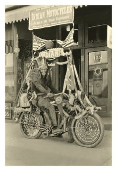 Black and White Photo of Man Dressed as Indian on Motorcycle
