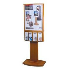 "This contemporary convex floor display is perfect for displaying any of our popular 22""w x 28""h promotional posters and/or a magnetic rate displays! This quality crafted wood floor display is available in 5 finishes to give you the flexibility to compliment your existing decor."