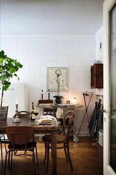 square white tile wall kitchen + mismatched chairs